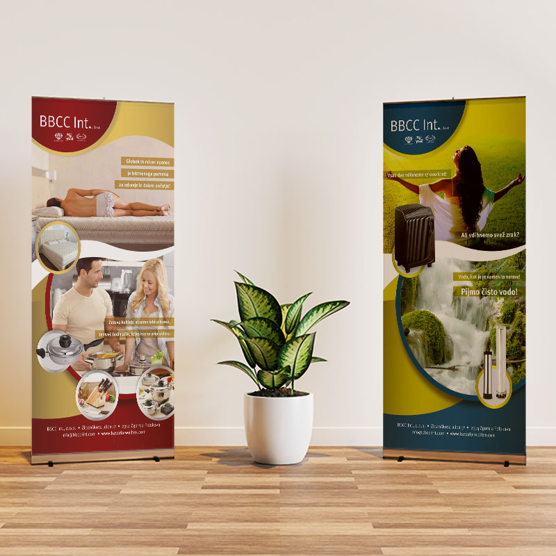 Two roll up banner mockup in interior scene with a plant in the